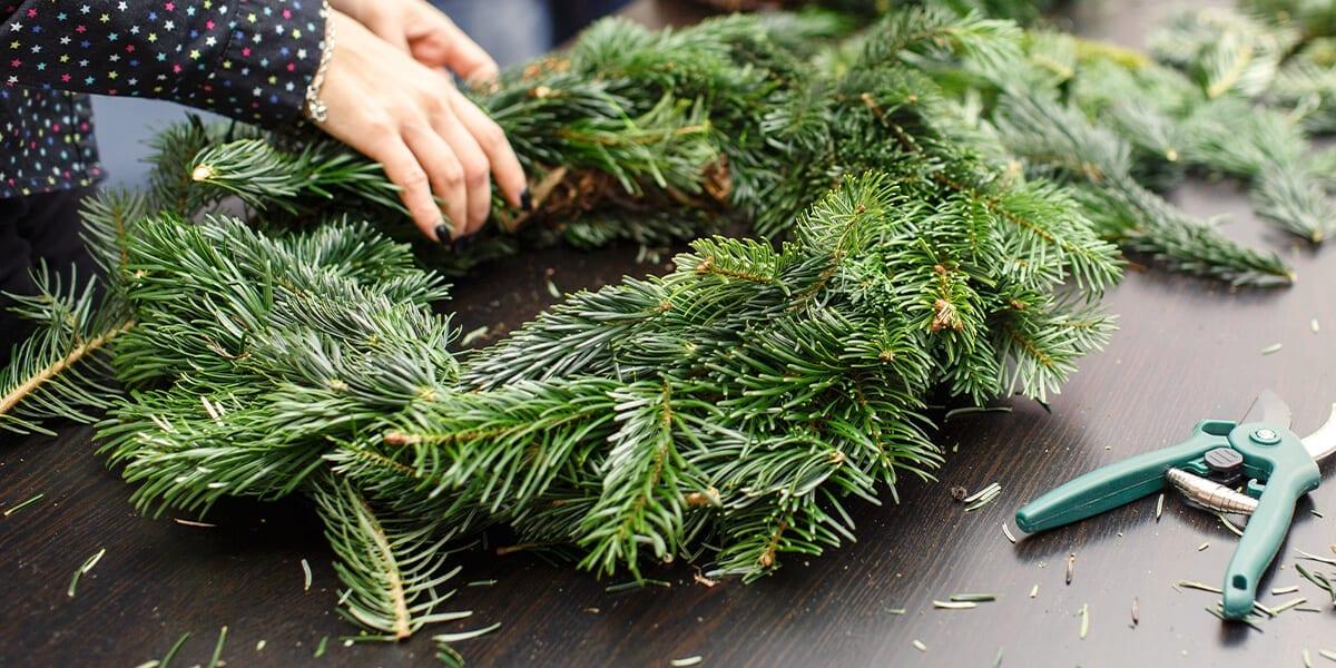 platt-hill-fresh-evergreen-crafts-person-making-wreath