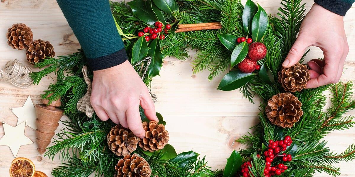 platt-hill-nursery-fall-to-winter-decor-person-making-natural-evergreen-wreath