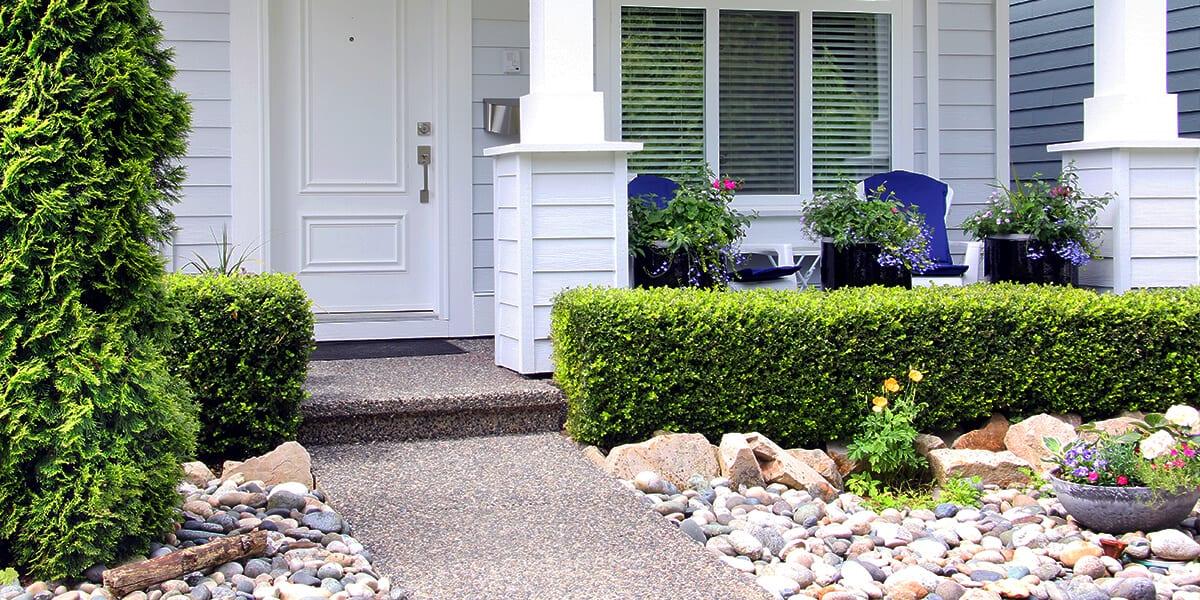 platt hill trends outdoor living front yard landscaping evergreen shrubs porch chairs